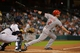 Sep 17, 2013; Houston, TX, USA; Cincinnati Reds shortstop Zack Cozart (2) hits a two-RBI single against the Houston Astros during the first inning at Minute Maid Park. Mandatory Credit: Thomas Campbell-USA TODAY Sports