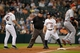 Sep 17, 2013; Houston, TX, USA; Cincinnati Reds third baseman Todd Frazier (21) reacts to umpire Wally Bell (35) calling at third base during the first inning against the Houston Astros at Minute Maid Park. Mandatory Credit: Thomas Campbell-USA TODAY Sports