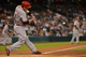 Sep 17, 2013; Houston, TX, USA; Cincinnati Reds third baseman Todd Frazier (21) hits an RBI single against the Houston Astros during the first inning at Minute Maid Park. Mandatory Credit: Thomas Campbell-USA TODAY Sports