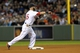 Sep 17, 2013; Boston, MA, USA; Boston Red Sox second baseman Dustin Pedroia (15) makes a throw to first base during the sixth inning against the Baltimore Orioles at Fenway Park. Mandatory Credit: Bob DeChiara-USA TODAY Sports