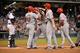 Sep 17, 2013; Houston, TX, USA; Cincinnati Reds right fielder Jay Bruce (32) celebrates hitting a grand slam with center fielder Shin-Soo Choo (17) and first baseman Joey Votto (19) and left fielder Derrick Robinson (15) against the Houston Astros during the fourth inning at Minute Maid Park. Mandatory Credit: Thomas Campbell-USA TODAY Sports