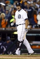 Sep 17, 2013; Detroit, MI, USA; Detroit Tigers third baseman Miguel Cabrera (24) reacts to shortstop Jose Iglesias (not pictured) scoring in the seventh inning against the Seattle Mariners at Comerica Park. Mandatory Credit: Rick Osentoski-USA TODAY Sports