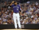 Sep 17, 2013; Denver, CO, USA; Colorado Rockies pitcher Juan Nicasio (12) reacts on the mound during the second inning against the St. Louis Cardinals at Coors Field. Mandatory Credit: Chris Humphreys-USA TODAY Sports