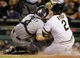 Sep 17, 2013; Pittsburgh, PA, USA; San Diego Padres catcher Nick Hundley (4) tags out Pittsburgh Pirates right fielder Marlon Byrd (2) at home plate during the third inning at PNC Park. The San Diego Padres won 5-2. Mandatory Credit: Charles LeClaire-USA TODAY Sports