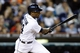 Sep 17, 2013; Detroit, MI, USA; Detroit Tigers center fielder Austin Jackson (14) hits an RBI single in the eighth inning against the Seattle Mariners at Comerica Park. Mandatory Credit: Rick Osentoski-USA TODAY Sports