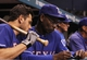 Sep 17, 2013; St. Petersburg, FL, USA; Texas Rangers manager Ron Washington (38) talks with second baseman Ian Kinsler (5) in the dugout against the Tampa Bay Rays at Tropicana Field. The Rangers won 7-1. Mandatory Credit: Kim Klement-USA TODAY Sports