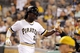 Sep 17, 2013; Pittsburgh, PA, USA; Pittsburgh Pirates center fielder Andrew McCutchen (22) is greeted at the dugout after scoring a run against the San Diego Padres during the third inning at PNC Park. The San Diego Padres won 5-2. Mandatory Credit: Charles LeClaire-USA TODAY Sports
