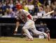 Sep 17, 2013; Denver, CO, USA; St. Louis Cardinals third baseman David Freese (23) hits a single during the sixth inning against the Colorado Rockies at Coors Field. Mandatory Credit: Chris Humphreys-USA TODAY Sports