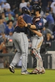 Sep 17, 2013; Kansas City, MO, USA; Cleveland Indians relief pitcher Chris Perez (54) celebrates with catcher Yan Gomes (10) after the game against the Kansas City Royals at Kauffman Stadium. The Indians won 5-3. Mandatory Credit: John Rieger-USA TODAY Sports