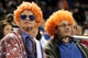Sep 17, 2013; New York, NY, USA; Mets fans wear colorful wigs during the seventh inning of a game between the New York Mets and the San Francisco Giants at Citi Field. Mandatory Credit: Brad Penner-USA TODAY Sports