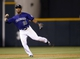 Sep 17, 2013; Denver, CO, USA; Colorado Rockies shortstop Jonathan Herrera (18) fields a ground ball during the eighth inning against the St. Louis Cardinals at Coors Field. The Cardinals won 11-4.  Mandatory Credit: Chris Humphreys-USA TODAY Sports