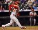 Sep 17, 2013; Denver, CO, USA; St. Louis Cardinals pinch hitter Kolten Wong (16) at bat during the eighth inning against the Colorado Rockies at Coors Field. The Cardinals won 11-4.  Mandatory Credit: Chris Humphreys-USA TODAY Sports