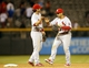 Sep 17, 2013; Denver, CO, USA; St. Louis Cardinals shortstop Daniel Descalso (33) celebrates with center fielder Jon Jay (19) after the game against the Colorado Rockies at Coors Field. The Cardinals won 11-4.  Mandatory Credit: Chris Humphreys-USA TODAY Sports