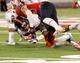 Sep 14, 2013; Tucson, AZ, USA; Arizona Wildcats safety Jared Tevis (38) tackles Texas-San Antonio Roadrunners wide receiver Brandon Freeman (84) during the third quarter at Arizona Stadium. The Wildcats defeated the Roadrunners 38-13. Mandatory Credit: Casey Sapio-USA TODAY Sports