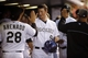 Sep 18, 2013; Denver, CO, USA; Colorado Rockies third baseman DJ LeMahieu (9) is greeted by teammates in the dugout after scoring during the first inning against the St. Louis Cardinals at Coors Field. Mandatory Credit: Chris Humphreys-USA TODAY Sports