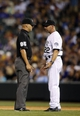 Sep 18, 2013; Denver, CO, USA; Colorado Rockies manager Walt Weiss (22) argues a call with second base umpire Bill Miller (85) during the fifth inning against the St. Louis Cardinals at Coors Field. Mandatory Credit: Chris Humphreys-USA TODAY Sports