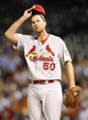 Sep 18, 2013; Denver, CO, USA; St. Louis Cardinals pitcher Adam Wainwright (50) reacts on the mound during the fourth inning against the Colorado Rockies at Coors Field.  Mandatory Credit: Chris Humphreys-USA TODAY Sports