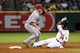Sep 18, 2013; Houston, TX, USA; Houston Astros right fielder L.J. Hoes (28) slides safely into second base during the sixth inning as Cincinnati Reds shortstop Zack Cozart (2) fields the throw at Minute Maid Park. Mandatory Credit: Troy Taormina-USA TODAY Sports