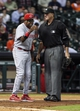 Sep 18, 2013; Houston, TX, USA; Cincinnati Reds manager Dusty Baker (12) discusses a call with home plate umpire Tim McClelland during the ninth inning against the Houston Astros at Minute Maid Park. Mandatory Credit: Troy Taormina-USA TODAY Sports