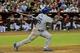 Sep 18, 2013; Phoenix, AZ, USA; Los Angeles Dodgers right fielder Yasiel Puig (66) hits a solo home run during fourth inning against the Arizona Diamondbacks at Chase Field. Mandatory Credit: Matt Kartozian-USA TODAY Sports