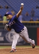Sep 18, 2013; St. Petersburg, FL, USA; Texas Rangers relief pitcher Joe Ortiz (58) throws a pitch during the twelfth inning against the Tampa Bay Rays at Tropicana Field. Tampa Bay Rays defeated the Texas Rangers 4-3 in twelve innings. Mandatory Credit: Kim Klement-USA TODAY Sports