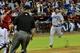 Sep 18, 2013; Phoenix, AZ, USA; Los Angeles Dodgers shortstop Nick Punto (7) runs towards home en route to scoring as Arizona Diamondbacks catcher Miguel Montero (26) waits for the ball during the sixth inning at Chase Field. Mandatory Credit: Matt Kartozian-USA TODAY Sports