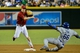 Sep 18, 2013; Phoenix, AZ, USA; Arizona Diamondbacks second baseman Aaron Hill (2) turns a double play as Los Angeles Dodgers right fielder Yasiel Puig (66) slides during the seventh inning at Chase Field. Mandatory Credit: Matt Kartozian-USA TODAY Sports