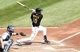 Sep 19, 2013; Pittsburgh, PA, USA; Pittsburgh Pirates shortstop Jordy Mercer (10) doubles against the San Diego Padres during the fourth inning at PNC Park. Mandatory Credit: Charles LeClaire-USA TODAY Sports