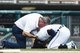 Sep 18, 2013; Detroit, MI, USA; Detroit Tigers trainer Keven Rand checks on shortstop Jose Iglesias (1) after getting hit by a pitch from Seattle Mariners relief pitcher Tom Wilhelmsen (not pictured) in the sixth inning at Comerica Park. Mandatory Credit: Rick Osentoski-USA TODAY Sports