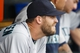 Sep 18, 2013; Detroit, MI, USA; Seattle Mariners relief pitcher Tom Wilhelmsen (54) watches from the dugout in the seventh inning against the Detroit Tigers at Comerica Park. Mandatory Credit: Rick Osentoski-USA TODAY Sports