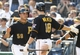 Sep 19, 2013; Pittsburgh, PA, USA; Pittsburgh Pirates catcher Tony Sanchez (59) is greeted after scoring a run by Pittsburgh Pirates second baseman Neil Walker (18) during the seventh inning at PNC Park. The Pittsburgh Pirates won 10-1. Mandatory Credit: Charles LeClaire-USA TODAY Sports