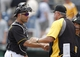Sep 19, 2013; Pittsburgh, PA, USA; Pittsburgh Pirates catcher Tony Sanchez (59) is greeted by manager Clint Hurdle (right) after defeating the San Diego Padres at PNC Park. The Pittsburgh Pirates won 10-1. Mandatory Credit: Charles LeClaire-USA TODAY Sports