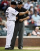 Sep 19, 2013; Denver, CO, USA; Colorado Rockies manager Walt Weiss (22) argues a call with home plate umpire Vic Carapazza (right) after calling out second baseman Jonathan Herrera (not pictured) during the twelfth inning against the St. Louis Cardinals at Coors Field. The Rockies won 7-6 in 15 innings.  Mandatory Credit: Chris Humphreys-USA TODAY Sports
