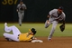 September 19, 2013; Oakland, CA, USA; Minnesota Twins shortstop Pedro Florimon (25, right) forces out Oakland Athletics first baseman Daric Barton (10, left) during the fourth inning at O.co Coliseum. Mandatory Credit: Kyle Terada-USA TODAY Sports