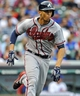 Sep 20, 2013; Chicago, IL, USA; Atlanta Braves infielder Andrelton Simmons runs to first base in the 9th inning of their game against the Chicago Cubs at Wrigley Field. Mandatory Credit: Matt Marton-USA TODAY Sports
