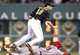 Sep 20, 2013; Pittsburgh, PA, USA; Pittsburgh Pirates second baseman Neil Walker (18) jumps over Cincinnati Reds first baseman Joey Votto (19) after throwing to first to complete a double play during the sixth inning at PNC Park. Mandatory Credit: Charles LeClaire-USA TODAY Sports