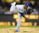 Sep 20, 2013; San Diego, CA, USA; Los Angeles Dodgers starting pitcher Edinson Volquez (30) throws during the first inning against the San Diego Padres at Petco Park. Mandatory Credit: Christopher Hanewinckel-USA TODAY Sports