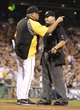 Sep 20, 2013; Pittsburgh, PA, USA; Pittsburgh Pirates manager Clint Hurdle (13) argues with home plate umpire Mark Carlson (right) after Andrew McCutchen (not pictured) was his by a pitch by the Cincinnati Reds during the eighth inning at PNC Park. Hurdle was ejected from the game. The Cincinnati Reds won 6-5 in ten innings. Mandatory Credit: Charles LeClaire-USA TODAY Sports