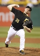 Sep 20, 2013; Pittsburgh, PA, USA; Pittsburgh Pirates relief pitcher Mark Melancon (35) delivers a pitch against the Cincinnati Reds during the ninth inning at PNC Park. The Cincinnati Reds won 6-5 in ten innings. Mandatory Credit: Charles LeClaire-USA TODAY Sports