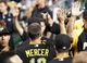 Sep 20, 2013; Pittsburgh, PA, USA; Pittsburgh Pirates shortstop Jordy Mercer (10) receives high-fives in the dugout after scoring against the Cincinnati Reds during the seventh inning at PNC Park. The Cincinnati Reds won 6-5 in ten innings. Mandatory Credit: Charles LeClaire-USA TODAY Sports