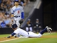 Sep 20, 2013; San Diego, CA, USA; San Diego Padres shortstop Ronny Cedeno (3) slides safely into third base during the eighth inning against the Los Angeles Dodgers at Petco Park. Mandatory Credit: Christopher Hanewinckel-USA TODAY Sports