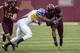Sep 21, 2013; Minneapolis, MN, USA; San Jose State Spartans cornerback Bene Benwikere (21) tackles Minnesota Golden Gophers wide receiver KJ Maye (1) in the first quarter at TCF Bank Stadium. Mandatory Credit: Jesse Johnson-USA TODAY Sports