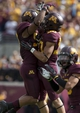 Sep 21, 2013; Minneapolis, MN, USA; Minnesota Golden Gophers linebacker Aaron Hill (57) and linebacker Jack Lynn (50) celebrate after stopping the San Jose State Spartans on a fourth down at TCF Bank Stadium. Mandatory Credit: Jesse Johnson-USA TODAY Sports