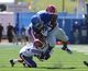 Sep 21, 2013; Lawrence, KS, USA; Kansas Jayhawks tight end Trent Smiley (85) is tackled by Louisiana Tech Bulldogs defensive back Lloyd Grogan (11) and defensive back Adairius Barnes (21) in the first half at Memorial Stadium. Mandatory Credit: John Rieger-USA TODAY Sports