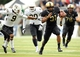 Sep 21, 2013; West Point, NY, USA; Army Black Knights running back Terry Baggett (31) runs past Wake Forest Demon Deacons quarterback Michael Radford (9) during the first half at Michie Stadium. Mandatory Credit: Danny Wild-USA TODAY Sports