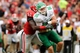 Sep 21, 2013; Athens, GA, USA; North Texas Mean Green tight end Drew Miller (86) is tackled by Georgia Bulldogs linebacker Amarlo Herrera (52) after a catch during the second quarter at Sanford Stadium. Mandatory Credit: Dale Zanine-USA TODAY Sports