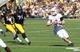 Sep 21, 2013; Iowa City, IA, USA; Western Michigan Broncos Quarterback Tyler Van Tubbergen (2) runs away from the Iowa Hawkeyes tackles Carl Davis (71) and Darian Cooper (97) at Kinnick Stadium. Mandatory Credit: Reese Strickland-USA TODAY Sports