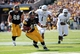 Sep 21, 2013; Iowa City, IA, USA; Western Michigan Broncos linebacker Mike Jones (1) chases running back Mark Weisman (45) of the Iowa Hawkeyes into the end zone at Kinnick Stadium. Mandatory Credit: Reese Strickland-USA TODAY Sports