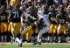 Sep 21, 2013; Iowa City, IA, USA; USA Iowa Hawkeyes cornerback B.J. Lowery (19) tackles the Western Michigan Broncos quarterback Tyler Van Tubbergen  (2) during the second quarter at Kinnick Stadium. Mandatory Credit: Reese Strickland-USA TODAY Sports