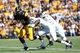 Sep 21, 2013; Iowa City, IA, USA; USA Iowa Hawkeyes tight end C.J. Fiedorowicz (86) runs away from two Western Michigan Broncos defenders during the first quarter at Kinnick Stadium. Mandatory Credit: Reese Strickland-USA TODAY Sports